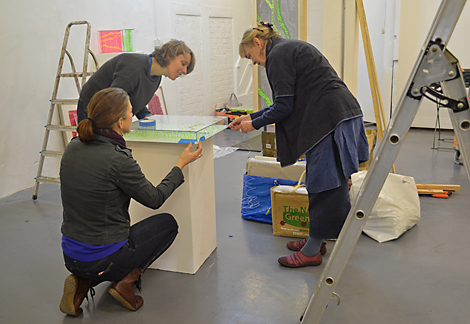 From left: Anna Glasbrook, Fiona Cassidy and Kirsten Glasbrook setting up