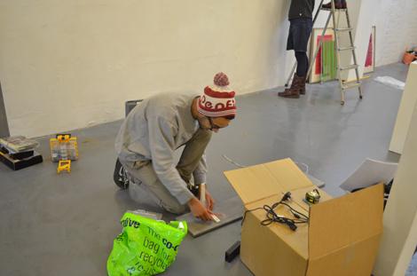 Samon Yechi fitting brackets on his shelf
