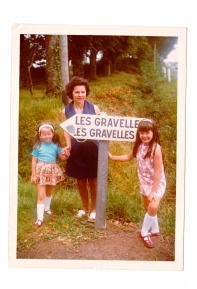 Lisa Gravelle – Brittany, France – Year unknown. Here we are in Brittany on holiday having found a village named after us! Thus proving to Mum that our pedigree is French/sophisticated etc... Lisa Gravelle is on the right, the one wearing the shift dress. Lisa's sister, Anna Gravelle, is the cheeky monkey pulling a face. Love the long white socks!
