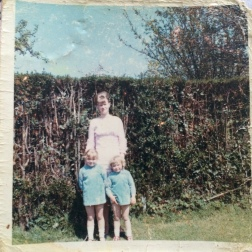 Laura, 1965, UK - my Nan, Mum and Aunty all in tiny shift dresses from around 1965! It was taken in my Great Grandmas back garden (UK) against the hedge the blackberries used to grow in. I love the image because I spent many childhood days here myself and I am almost certain Nan made these matching children's shift dresses herself. She's the one who inspires me to sew today.