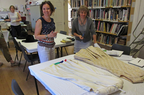 Desiree and Anna discussing BATMC I.09.396, Debebnham & Freebody, 1960 - 1969, silk synthetic, woven (brocade) quilted.
