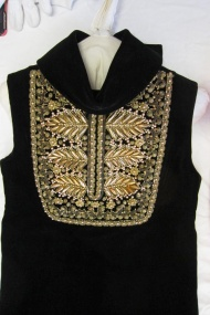 Not catalogued, Christian Dior Boutique, 1960's, black velvet with embellished bib. The black velvet sets off the embroidery nicely. The neck looked as though it could be quite tight with hooks and eyes to fasten it at the back.