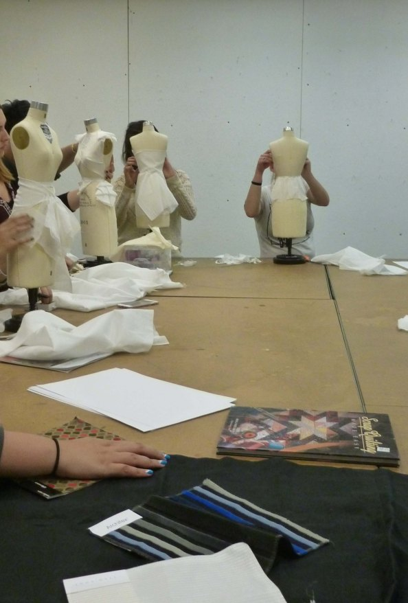 Students draping on mannequins