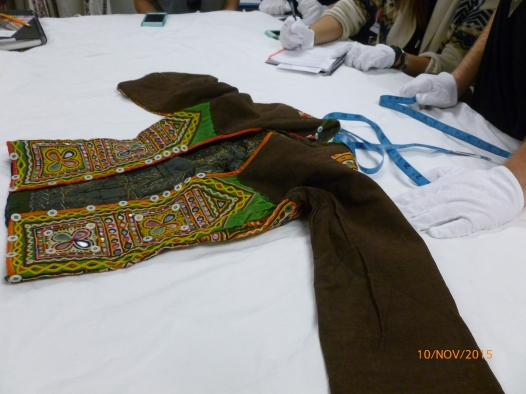 Students studying traditional garments