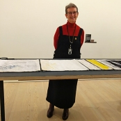 3. Jilly Edwards at her table of gorgeous tapestries forming her work Elements